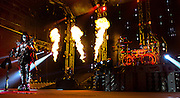 Gene Simmons of KISS plays guitar with fire behind him as the band begins the start of their residency at The Joint within the Hard Rock Hotel on Wednesday, November 5, 2014. L.E. Baskow
