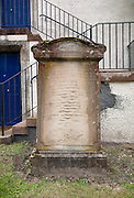 Eroded script on tombstone in the churchyard at Traquair Church, Kirkhouse near Innerleithen in the Scottish Borders. built in 1778