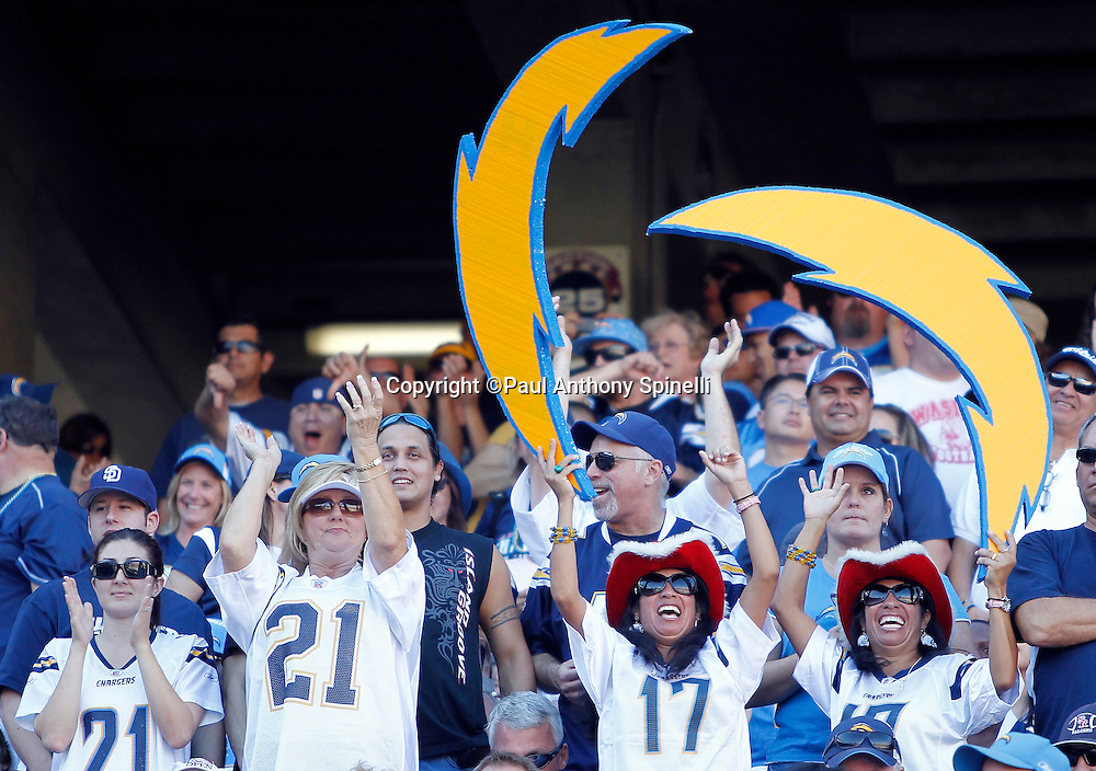 San Diego Chargers fans with lightning bolts cheer during the NFL week 14 football game against the Kansas City Chiefs on Sunday, December 12, 2010 in San Diego, California. The Chargers won the game 31-0. (©Paul Anthony Spinelli)