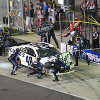 NASCAR Sprint Cup driver Jimmie Johnson (48)  makes a pit stop during the NASCAR Coke Zero 400 Sprint series auto race at the Daytona International Speedway on Saturday, July 6, 2013 in Daytona Beach, Florida.  (AP Photo/Alex Menendez)