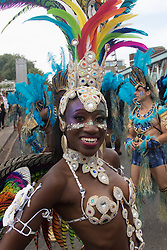 London, August 29th 2016. A woman stops to pose for the camera during day two of Europe's biggest street party, the Notting Hill Carnival.