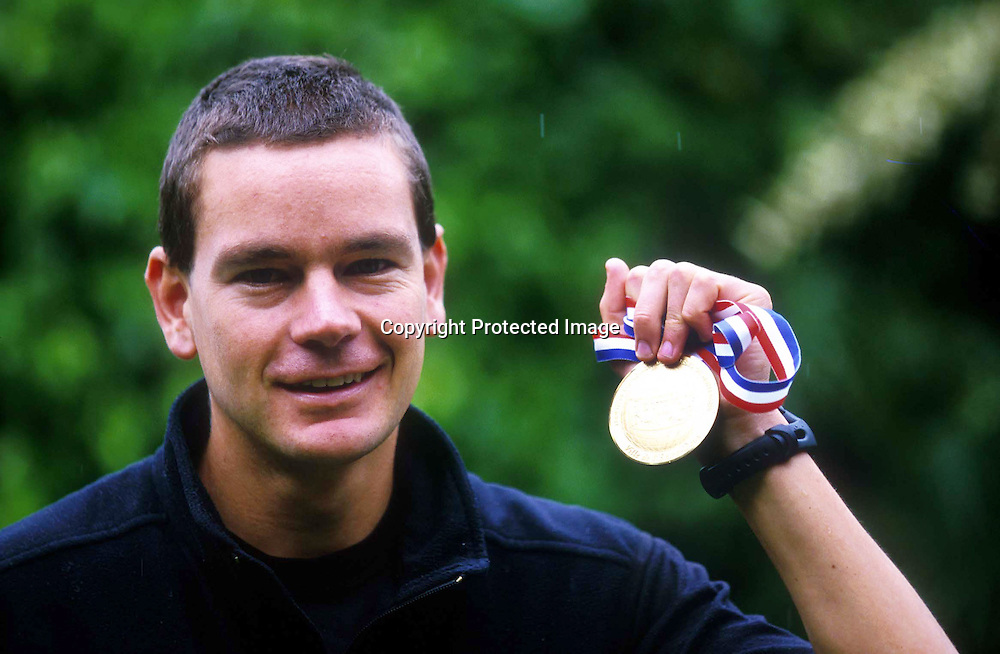 Jonathon Wyatt of New Zealand with his winning medal from the World Mountain Running Trophy race held in Reunion Island, Indian Ocean 1998. Photo: Photosport.co.nz