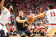 LUBBOCK, TX - MARCH 1: Jacob Young #3 of the Texas Longhorns drives to the basket against Aaron Ross #15 of the Texas Tech Red Raiders during the game on March 1, 2017 at United Supermarkets Arena in Lubbock, Texas. Texas Tech defeated Texas 67-57. (Photo by John Weast/Getty Images) *** Local Caption *** Jacob Young;Aaron Ross