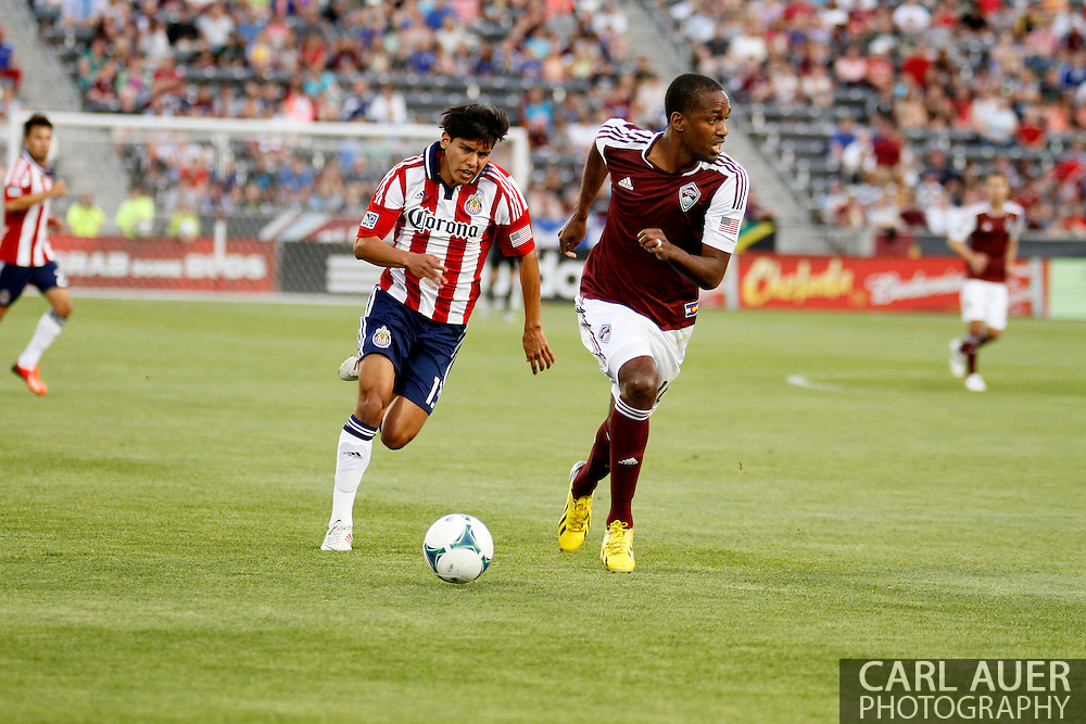 May 25th, 2013 Commerce City, CO - Colorado Rapids midfielder Atiba Harris (16) brings the ball up the field past Chivas USA midfielder Josue Soto (13) in first half action of the MLS match between Chivas USA and the Colorado Rapids at Dick's Sporting Goods Park in Commerce City, CO