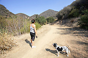 woman and her dog at Pratt Trail, Ojai, Ventura County, California, USA