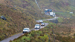 Arrochar, Scotland, UK. 30 January, 2020. An overnight landslide blocked the A83 at Rest and Be Thankful pass through Glen Crow near Arrochar. Traffic  is being diverted onto adjacent single track Old Military Road. Vehicles were escorted under convey system in each direction. Contractor BEAR working to clear debris from the A83 carriageway in very poor weather conditions. Masterton/Alamy Live News