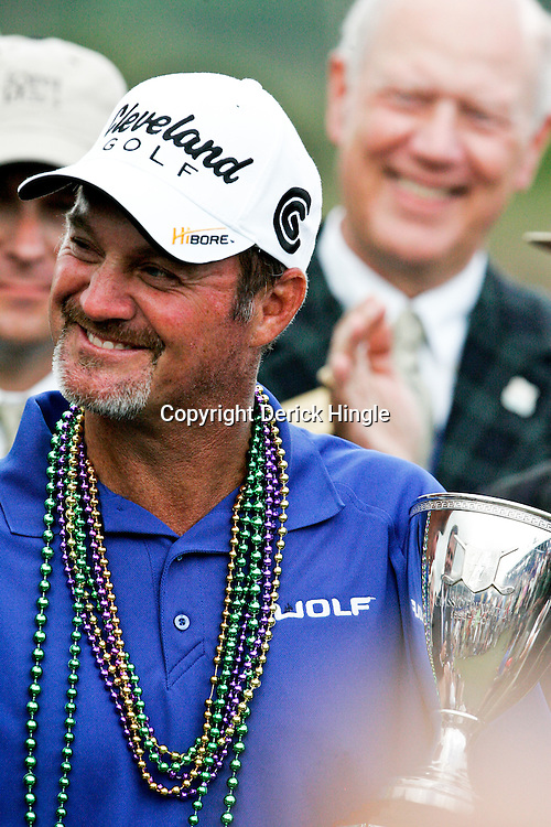 2009 April 26: PGA Tour golf pro Jerry Kelly holds the Zurich Classic of New Orleans championship trophy after winning the tournament's final round at TPC Louisiana in Avondale, Louisiana.