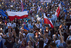 July 22, 2017 - Poland - Anti-government protesters gathering in Main Square in Krakow , raise candles and shout slogans during a demonstration against a new bill changing the judiciary system in Krakow, Poland on July 22 , 2017. (Credit Image: © Jakub Wlodek/NurPhoto via ZUMA Press)