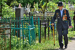 May 1, 2019 - Tambov, Tambov region, Russia - Veteran of the great Patriotic war (world war II) is on the path between the graves, on Vozdvizhensky cemetery  (Credit Image: © Demian Stringer/ZUMA Wire)