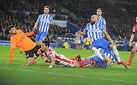 Football - 2017 / 2018 Premier League - Brighton & Hove Albion vs. Stoke City<br /> <br /> Ramadan Sobhi of Stoke is foiled by Goalkeeper Mathew Ryan, Lewis Dunk and Bruno of Brighton at The Amex.<br /> <br /> COLORSPORT/ANDREW COWIE
