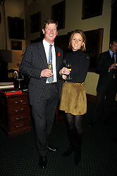 LT.COL CRISPIN LOCKHART and his wife LUCY at a reception to support The Hyde Park Appeal held in the officers Mess, Household Cavalry Mounted Regiment, Hyde Park Barracks, London SW1 on 10th November 2008.