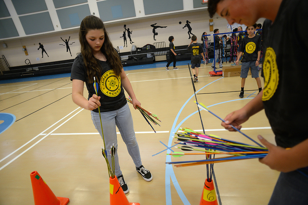 apl050817b/SPORTS/pierre-louis/JOURNAL 050817<br /> James Monroe Middle School Archery teammates Abigail Carlsen, 12,  left and  Walker Schultz,,12,  get ready for  practice . The team recently won a state championship and  will compete in Kentucky May 11 -14  .Photographed on Monday May 8 2017. .Adolphe Pierre-Louis/JOURNAL
