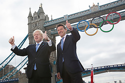 © licensed to London News Pictures. London, UK 27/06/2012. Mayor of London Boris Johnson and Lord Sebastian Coe unveil giant Olympic rings which are displayed from Tower Bridge, today. Photo credit: Tolga Akmen/LNP