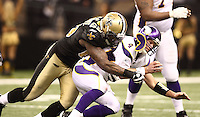 NEW ORLEANS - JANUARY 24: Brett Favre #4 of Minnesota Vikings  is hit by Anthony Hargrove #69 of the New Orleans Saints at the NFC Championship Game at the Louisiana Superdome on January 24, 2010 in New Orleans, Louisiana. The Saints won 31-28 in overtime to advance to the Super Bowl for the first time. Photo by Tom Hauck.