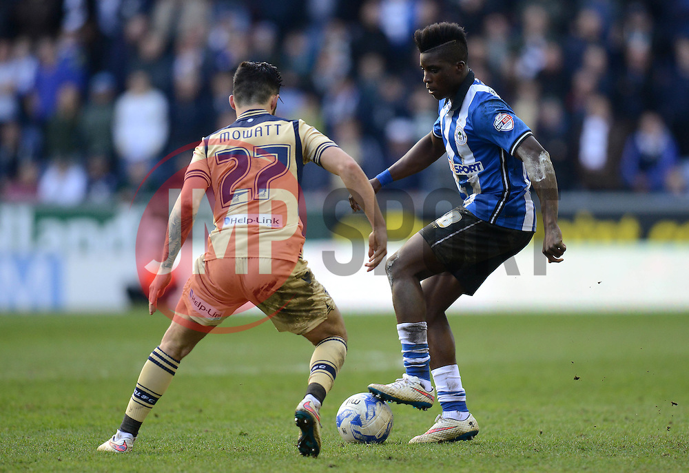 Wigan Athletic's Sheyi Ojo competes with Leed\s United's Alex Mowatt - Photo mandatory by-line: Richard Martin-Roberts/JMP - Mobile: 07966 386802 - 07/03/2015 - SPORT - Football - Wigan - DW Stadium - Wigan Athletic v Leeds United - Sky Bet Championship