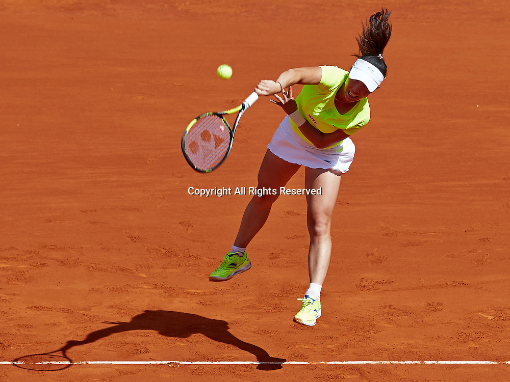 06.05.2014 Madrid, Spain. Jie Zheng of China serves the ball during the game with Na Li of China on day 3 of the Madrid Open from La Caja Magica.