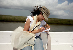 07 June 2010. Pointe aux Chenes, Louisiana.<br /> Fading away. French reporter Alexandra Gonzalez writes passionately from the region. The precious wetlands south of Pointe Aux Chenes. Through years of erosion, much of this was once solid ground. Diversion of the mighty Mississippi River diverted sediment from the wetlands and deposited precious land building material deep out at sea.  At present, all these fishing grounds are closed. Members of the Pointe aux Chenes Indians, settlers that can trace their roots beyond 5 generations back to France. French cajun is the language of the elders, but is dying out in the children of today. BP's catastrophic oil spill threatens the tribe's very existence, their way of life and the land on which they live. Not recognised by the federal government, the 680 member tribe struggles for funds in a small community that survives only because of fishing and oil extraction in the Gulf of Mexico.<br /> Life will never be the same again. The ecological and economic impact of BP's oil spill is devastating to the region. Oil from the Deepwater Horizon catastrophe is evading booms laid out to stop it thanks in part to the dispersants which means the oil travels at every depth of the Gulf and washes ashore wherever the current carries it. The Louisiana wetlands produce over 30% of America's seafood and oil and gas production. They are the most fertile wetlands and nurseries of their kind in the world.<br /> Photo; Charlie Varley/varleypix.com
