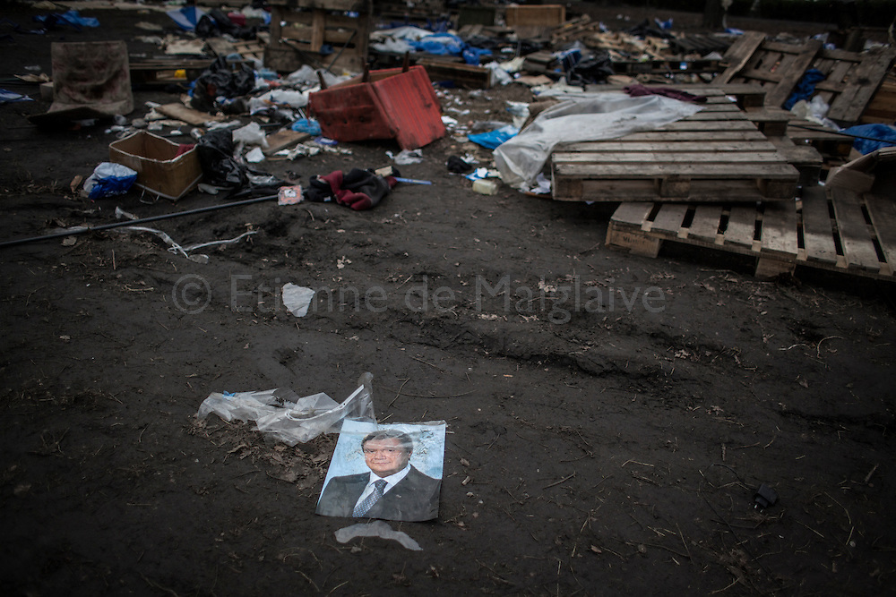 A portrait of former of Ukrainian President Viktor Yanukovych lays on the ground of the deserted camp site of the titushkys (pro-government thugs) in Mariinski park next to the parliament on February 22, 2014 in Kiev, Ukraine.