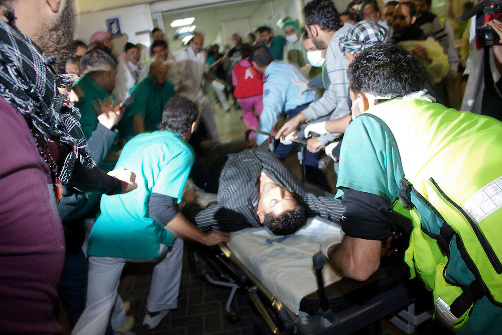 Protesters are brought into Salmnyia Medical Complex in Manama, Bahrain to be treated after being shot at by the police.