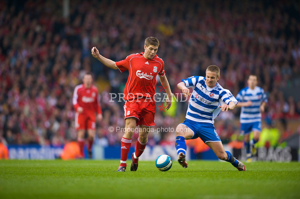 LIVERPOOL, ENGLAND - Saturday, March 15, 2008: Liverpool's captain Steven Gerrard MBE and Reading's Kevin Doyle in action during the Premiership match at Anfield. (Photo by David Rawcliffe/Propaganda)