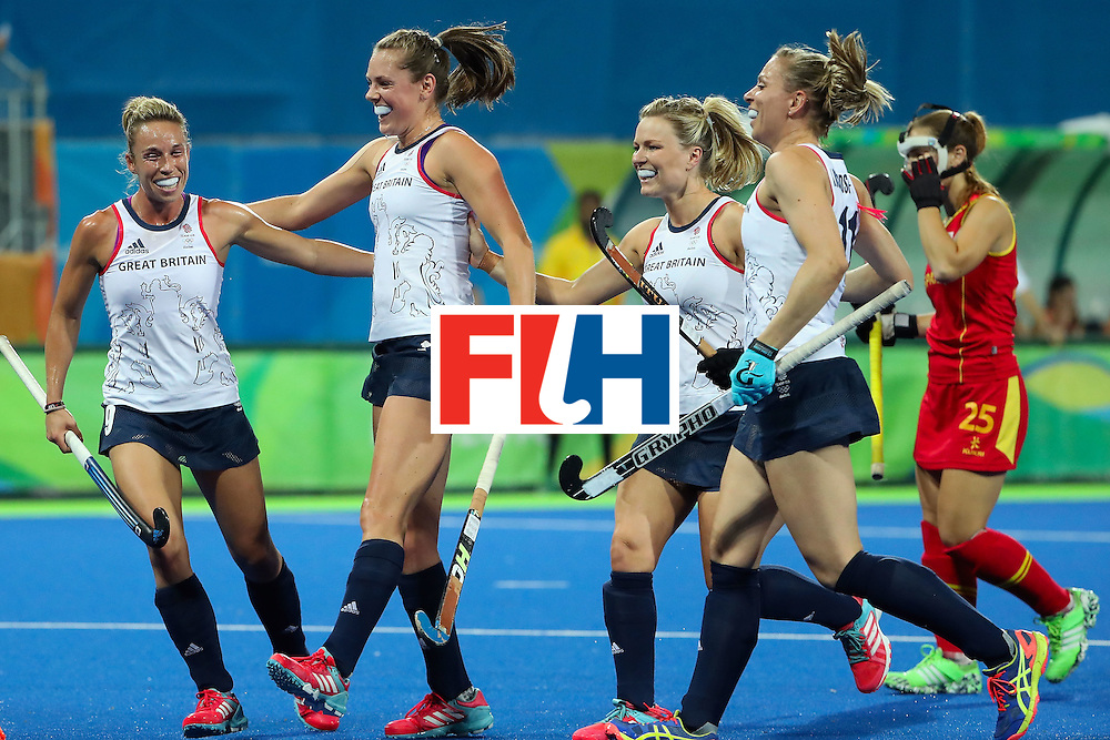 RIO DE JANEIRO, BRAZIL - AUGUST 15:  (L-R) Susannah Townsend #9, Giselle Ansley #18, Kate Richardson-Walsh #11 and Hollie Webb #20 of Great Britain celebrate after Georgie Twigg (not pictured) scored a first half goal against Spain during the quarter final hockey game on Day 10 of the Rio 2016 Olympic Games at the Olympic Hockey Centre on August 15, 2016 in Rio de Janeiro, Brazil.  (Photo by Christian Petersen/Getty Images)