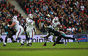 Buffalo Bills EJ Manuel about to make a pass before being tackled by Jacksonville Jaguars Andre Branch during the Buffalo Bills v Jacksonville Jaguars NFL International Series match at Wembley Stadium, London, England on 25 October 2015. Photo by Matthew Redman.