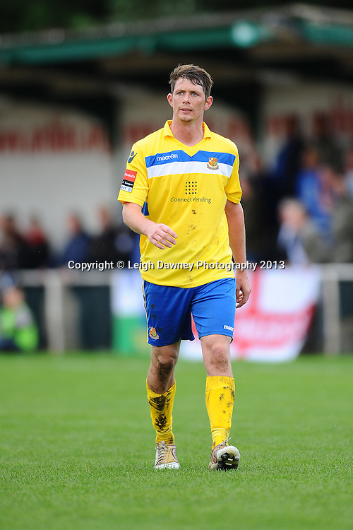 Sean Cronin of Wealdstone leaves the pitch after being handed a red card for a foul by referee Ian Fissenden. AFC Hornchurch v Wealdstone at The Stadium, Bridge Avenue, Upminster, Essex. FA Cup 3rd Qualifying Round. 12th October 2013. © Leigh Dawney Photography 2013.