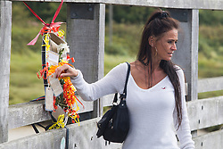 © Licensed to London News Pictures. 22/08/2016. Shoreham-by-Sea, UK. Family members, dignitaries and members of the public holding a one minute silence in memory of the 11 victims who died one year ago today when a Hunter Hawker Jet crashed during the 2015 Shoreham Airshow. Photo credit: Hugo Michiels/LNP