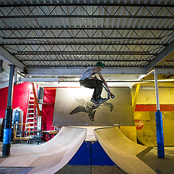 Staten Island, NY (Saturday, March 15, 2014): Austin Chinese, 16-year-old scooterer riding at the 5050 Skatepark, New York's only full-size indoor park for skateboarders, BMXers and scooterers and other mildly disaffected youth.
