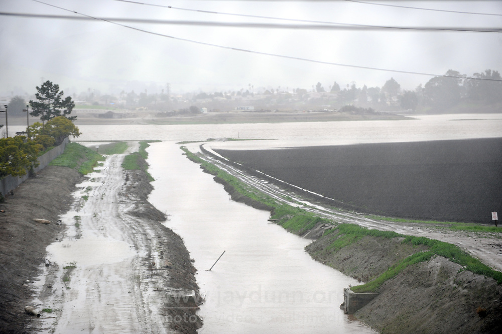 Photographed from the Sherwood Drive bridge over Hwy 101 in Salinas, heavy rain on Sunday afternoon flows down the Main Canal into Carr Lake.