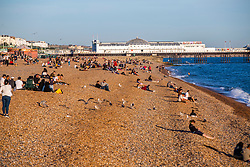 © Licensed to London News Pictures. 17/09/2016. Brighton, UK. Members of the public relax on the beach in Brighton and Hove as sunny weather is hitting the seaside resort. Photo credit: Hugo Michiels/LNP