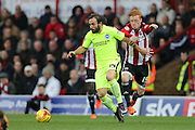 Brighton defender, full back, Inigo Calderon (14) during the Sky Bet Championship match between Brentford and Brighton and Hove Albion at Griffin Park, London, England on 26 December 2015.