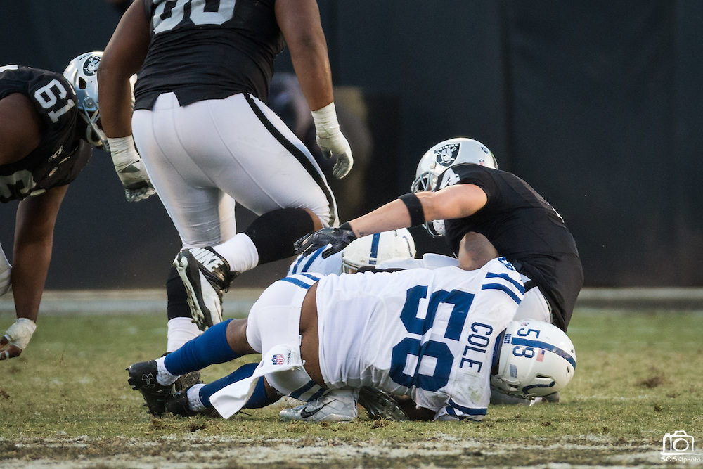 Indianapolis Colts outside linebacker Trent Cole (58) sacks Oakland Raiders quarterback Derek Carr (4) late in the game at Oakland Coliseum in Oakland, Calif., on December 24, 2016. (Stan Olszewski/Special to S.F. Examiner)