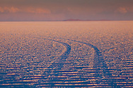 Informal roads appear on the surface of the Salar de Uyuni in southwest Bolivia.