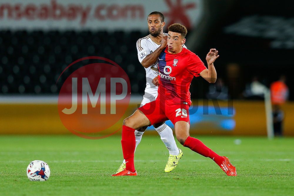 Ben Godfrey of York City is challenged by Wayne Routledge of Swansea City - Mandatory byline: Rogan Thomson/JMP - 07966 386802 - 25/08/2015 - FOOTBALL - Liberty Stadium - Swansea, Wales - Swansea City v York City - Capital One Cup Second Round.