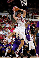 February 13, 2010; Stanford, CA, USA;  Stanford Cardinal forward Jack Trotter (50) grabs a rebound from Washington Huskies guard Isaiah Thomas (2) during the first half at Maples Pavilion.  Washington defeated Stanford 78-61.