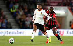 Ruben Vezo of Valencia passes the ball under pressure from Benik Afobe of Bournemouth - Mandatory by-line: Robbie Stephenson/JMP - 03/08/2016 - FOOTBALL - Vitality Stadium - Bournemouth, England - AFC Bournemouth v Valencia - Pre-season friendly