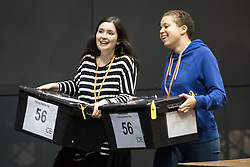 © Licensed to London News Pictures . 08/06/2017 . Manchester , UK . Ballot boxes being carried in to the count for the constituencies of Blackley and Broughton, Manchester Central, Manchester Gorton, Manchester Withington and Wythenshawe and Sale East, in the General Election, at the Manchester Central Convention Centre . Photo credit : Joel Goodman/LNP