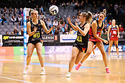 Magic wing defense Hayley Saunders fires a pass to Magic wing attack Ariana Cable-Dixon during the ANZ Premiership netball match - Magic v Tactix played at Claudelands Arena, Hamilton, New Zealand on 30 July 2018.<br /> <br /> Copyright photo: © Bruce Lim / www.photosport.nz
