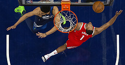 April 23, 2018 - Minneapolis, MN, USA - Houston Rockets' Trevor Ariza (1) attempted a shot while being defended by the Timberwolves' Karl-Anthony Towns (32) in the first half of Game 4 of their series Monday, April 23, 2018 at the Target Center in Minneapolis, Minn. The Rockets won, (Credit Image: © Carlos Gonzalez/TNS via ZUMA Wire)