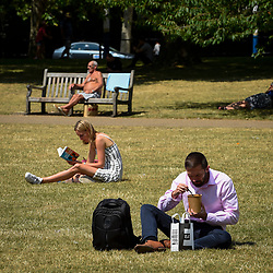 © Licensed to London News Pictures. 16/07/2019. LONDON, UK.  People relax in the sunshine in St. James's Park.  Temperatures are forecast to rise to 26C.  Photo credit: Stephen Chung/LNP