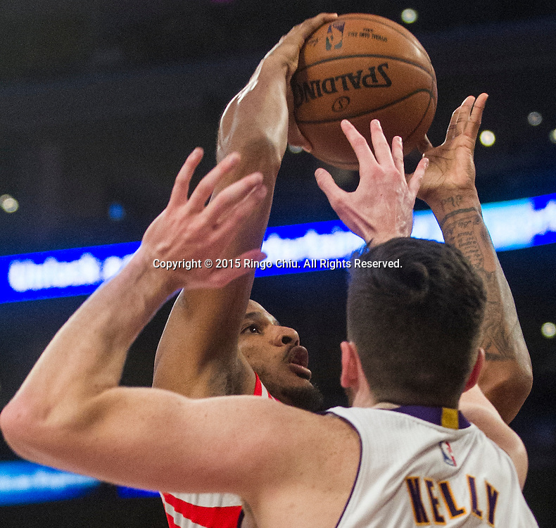 Houston Rockets forward Trevor Ariza (1) goes up against Los Angeles Lakers forward Ryan Kelly (4) during their NBA game at Staples Center in Los Angeles, California on January 25, 2015 . Rockets defeated Lakers 99-87. (Photo by Ringo Chiu/PHOTOFORMULA.com)