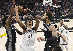 March 1, 2018 - Sacramento, CA, USA - The Brooklyn Nets' Jarrett Allen (31) tries to get a shot off between the Sacramento Kings' De'Aaron Fox, left, and Willie Cauley-Stein in the first quarter at the Golden 1 Center in Sacramento, Calif., on Thursday, March 1, 2018. (Credit Image: © Hector Amezcua/TNS via ZUMA Wire)