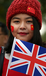© Licensed to London News Pictures. 20/10/2015. London, UK. A girl carries a Chinese flag in The Mall ahead of Chinese President Xi Jinping's four day State Visit to the United Kingdom. Photo credit: Peter Macdiarmid/LNP