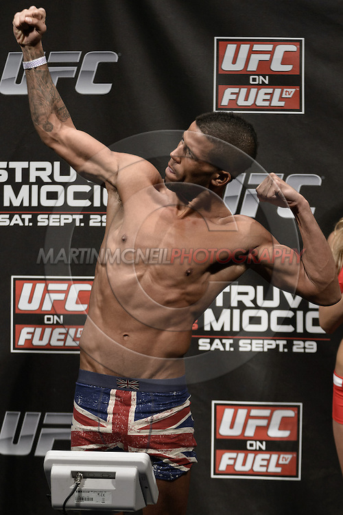 "NOTTINGHAM, ENGLAND, SEPTEMBER 28, 2012: Jason Young poses on the scales during the official weigh-in for ""UFC on Fuel TV 5: Struve vs. Miocic"" inside the Capital FM Arena in Newcastle, United Kingdom on Friday, September 28, 2012 © Martin McNeil"