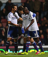 Picture by David Horn/Focus Images Ltd +44 7545 970036<br /> 23/11/2013<br /> Oscar of Chelsea (centre) celebrates scoring his team's second goal with Branislav Ivanovic of Chelsea (left) and Ramires of Chelsea (right) during the Barclays Premier League match at the Boleyn Ground, London.