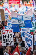 The march sets off, a sea of placards and messages - A march against cuts to and potential privatisation of the NHS starts in Tavistock Square and heads for Parliament Square. The march was organised by the peoples assembly and supported by most major unions and the Labour Party.