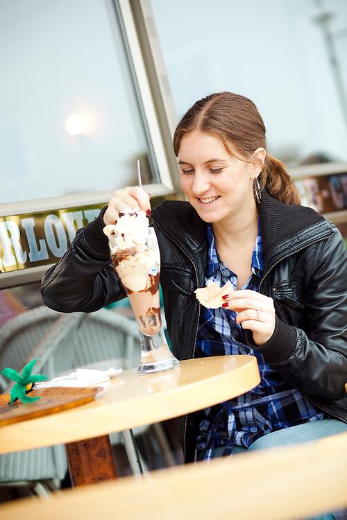 Journalist Helen Ochyra tucks into ice cream. Morellis Ice Cream Parlour, Broadstairs, Kent