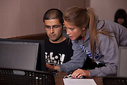 Student volunteer Sarah Weisenberger (Right) assists international student Ahmad Al- Tarawnah complete his tax forms at a volunteer income tax assistance program offered by the College of Business at Ohio University.