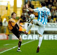 Photo: Ed Godden.<br />Wolverhampton Wanderers v Brighton & Hove Albion. Coca Cola Championship. 22/04/2006. Tomasz Frankowski (L) is challenged by Brighton's Joel Lynch.